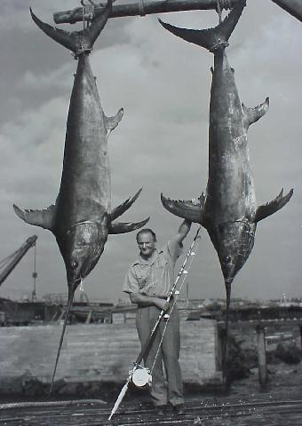 photo of Michael Lerner and two massive swordfish from his 1940 Peru-Chile Expedition
